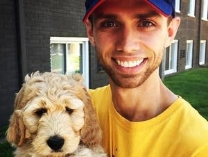 Connor McCarthy and his puppy, Brentley, a Goldendoodle.