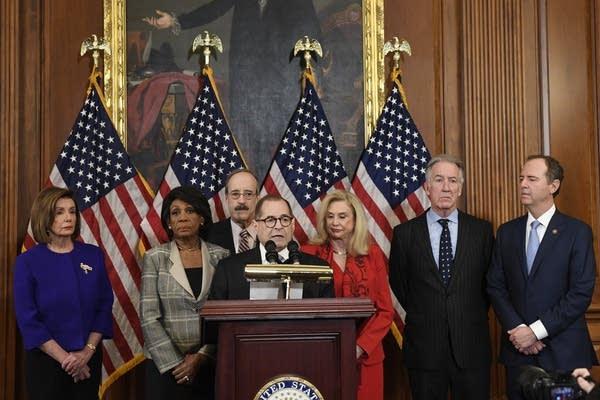 Democratic House leaders unveil articles of impeachment against Trump.