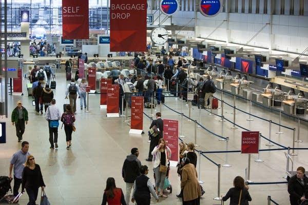 Travelers at Minneapolis-Saint Paul airport