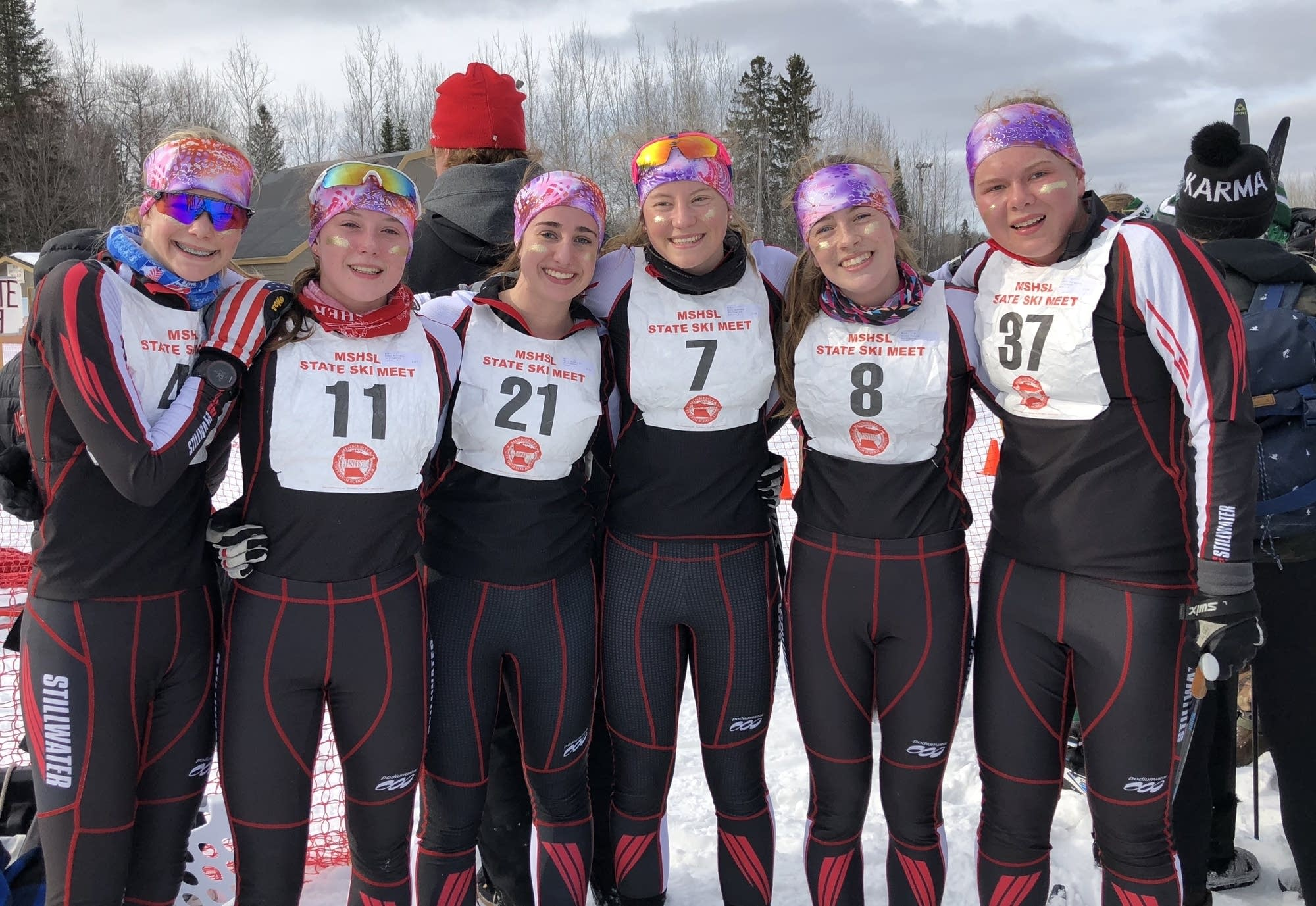 Stillwater girls cross country ski team wears glitter, Diggins-style.