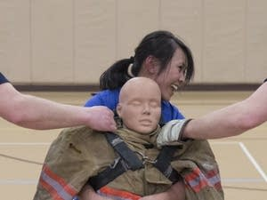 MPR News' Nancy Yang drags a body dummy.