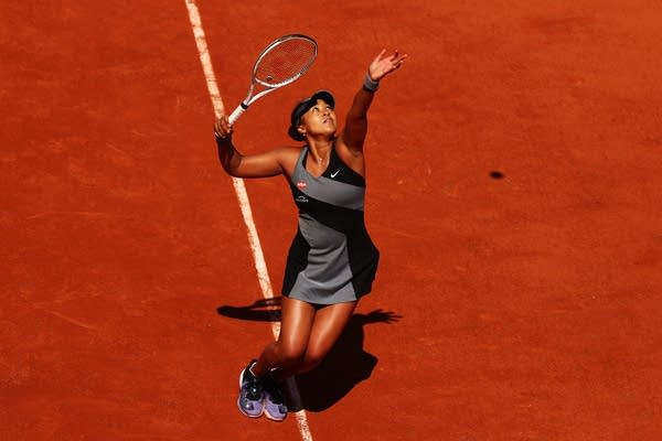 A woman plays tennis.