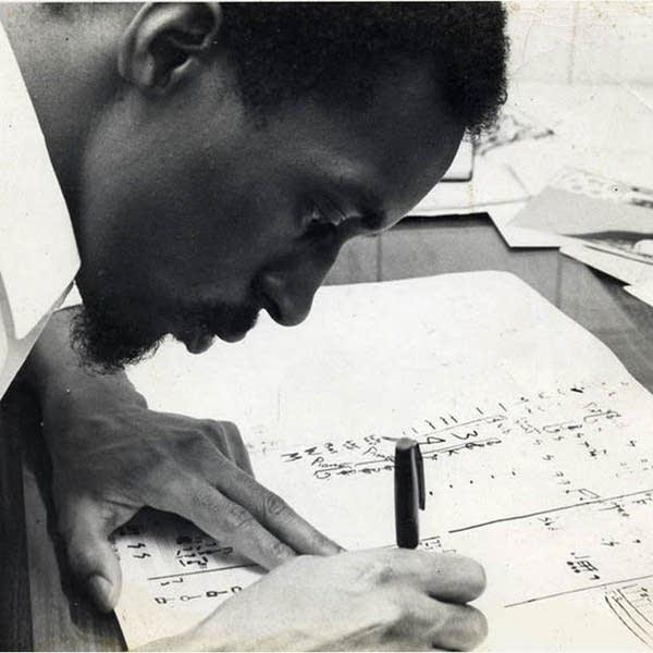 Julius Eastman working on a score