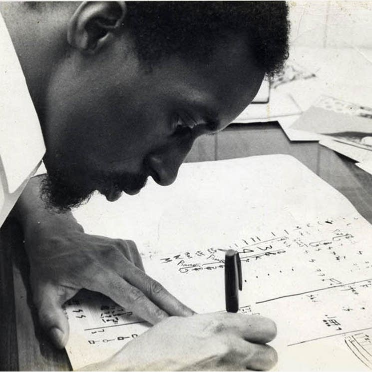 Julius Eastman works on a score.