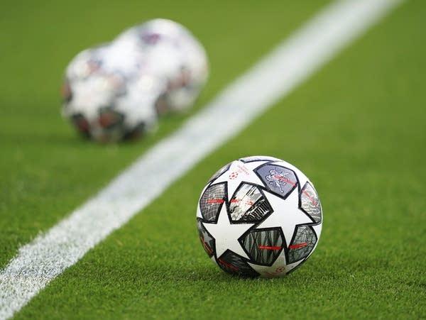 Soccer balls on a soccer field