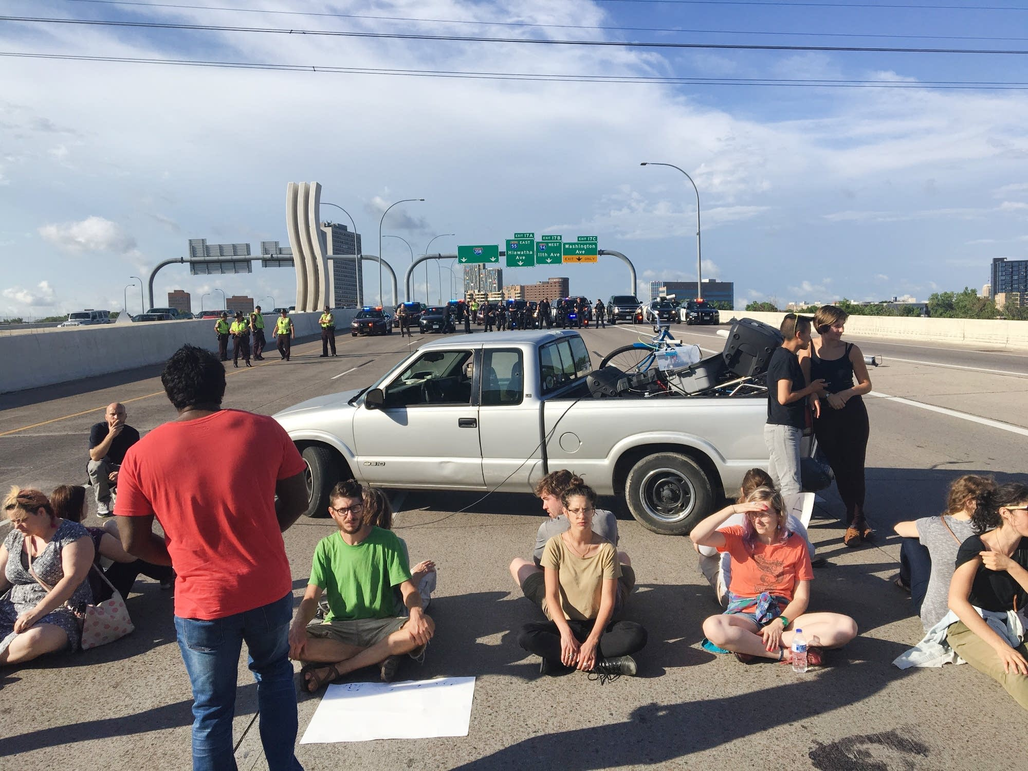Protesters line up on I-35W