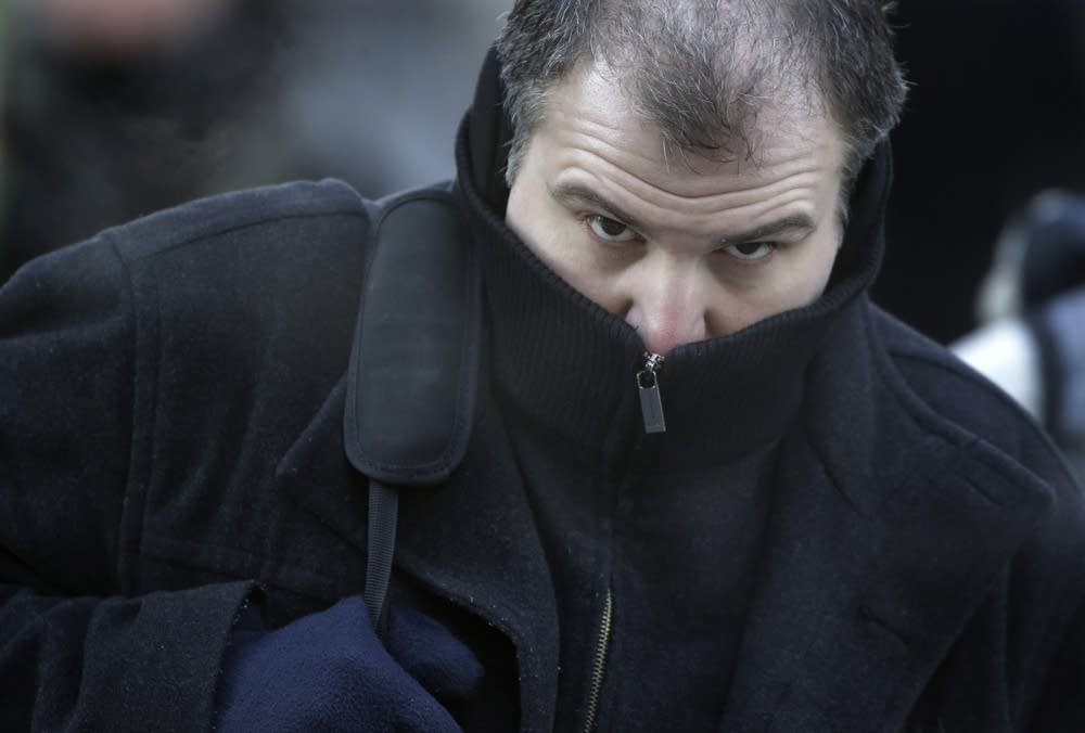 A commuter bundles up against extreme cold