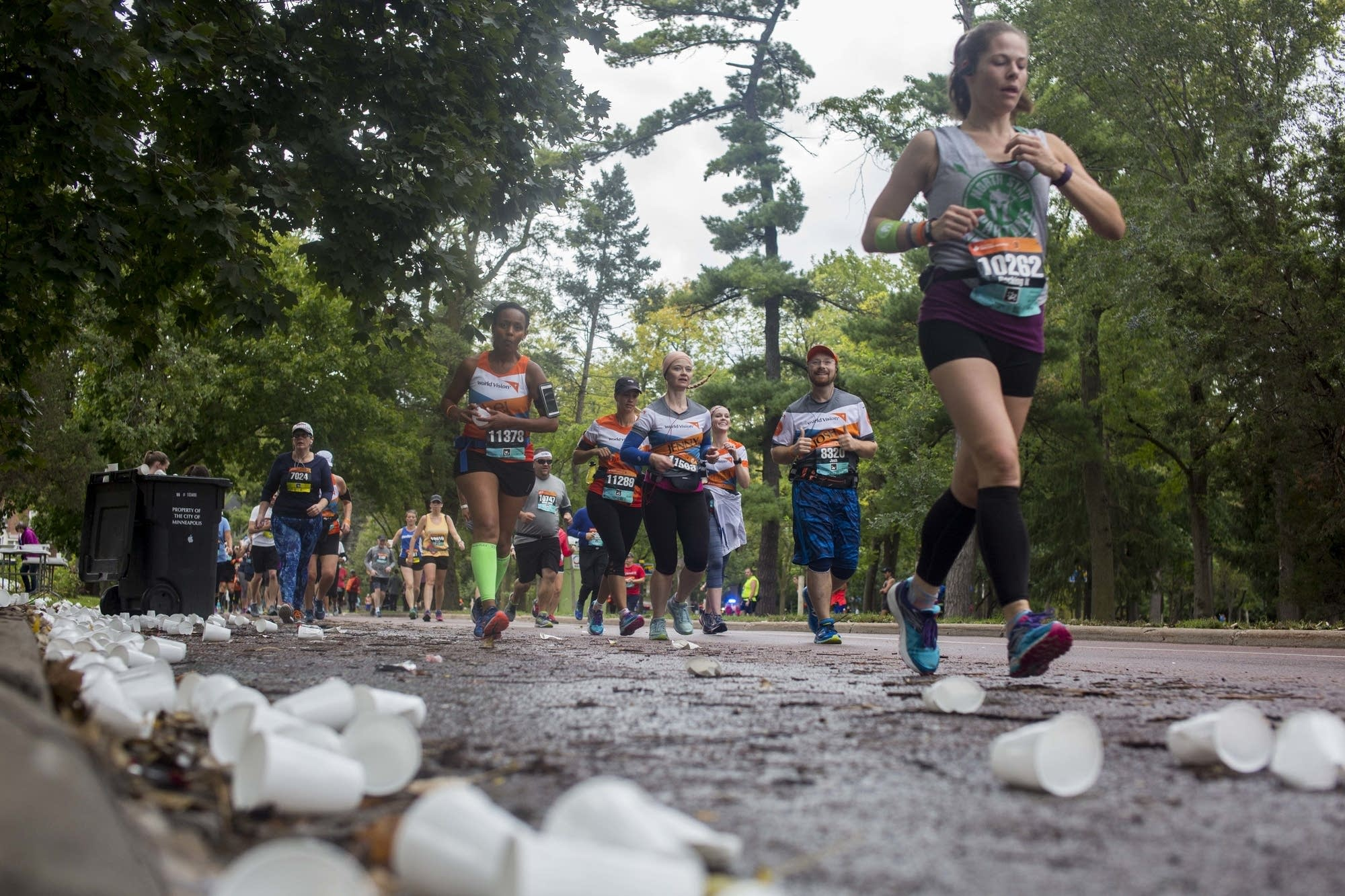 Runners ditch their water cups.