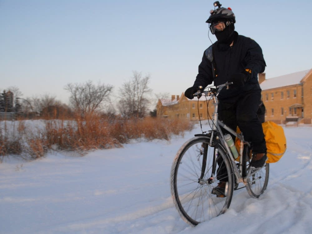 Paul Stewart riding through Fort Snelling