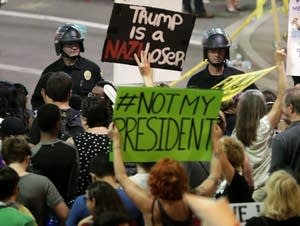 People protest outside the Phoenix Convention Center.