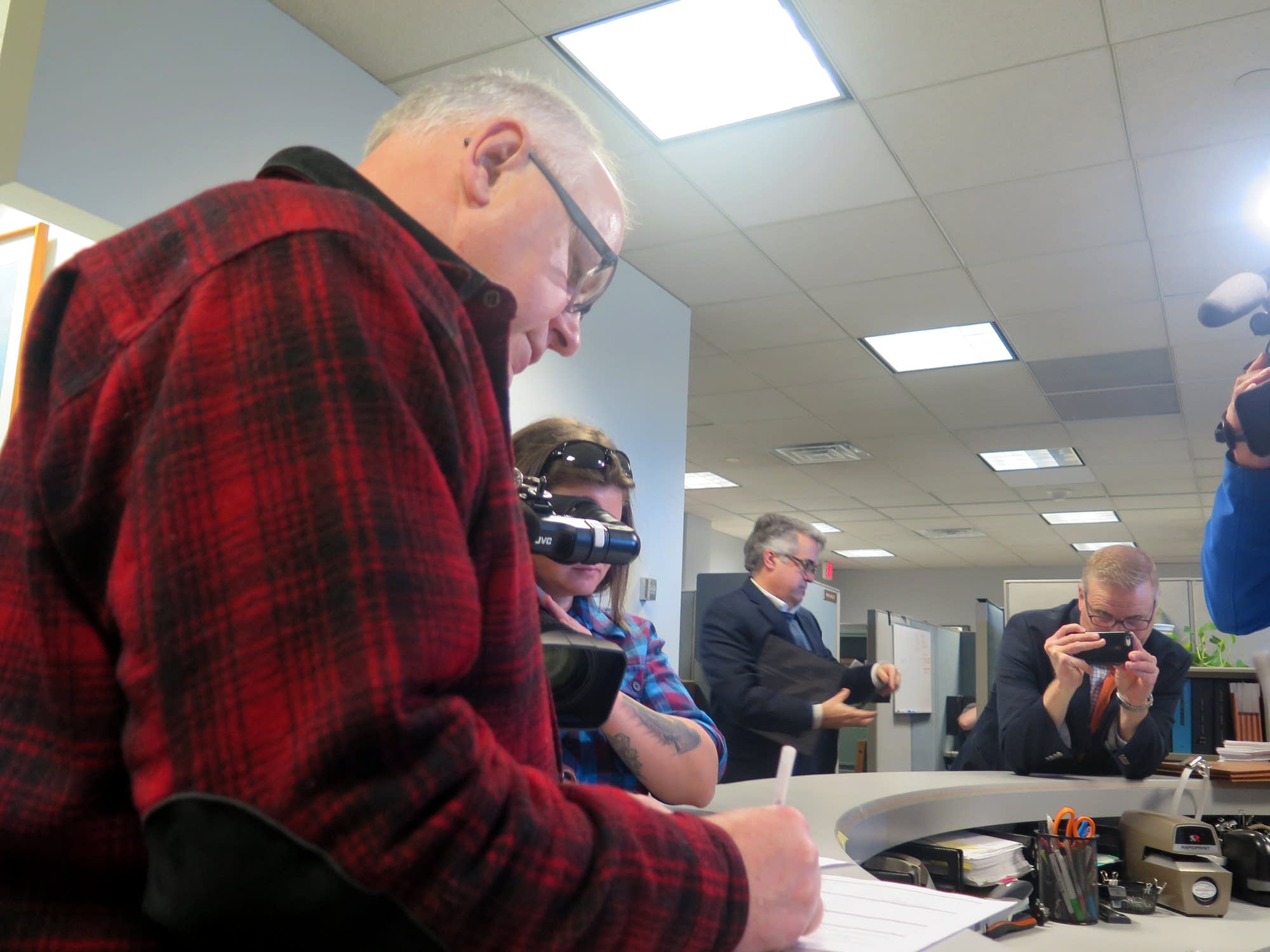 Tim Walz signs paperwork creating a campaign account for governor