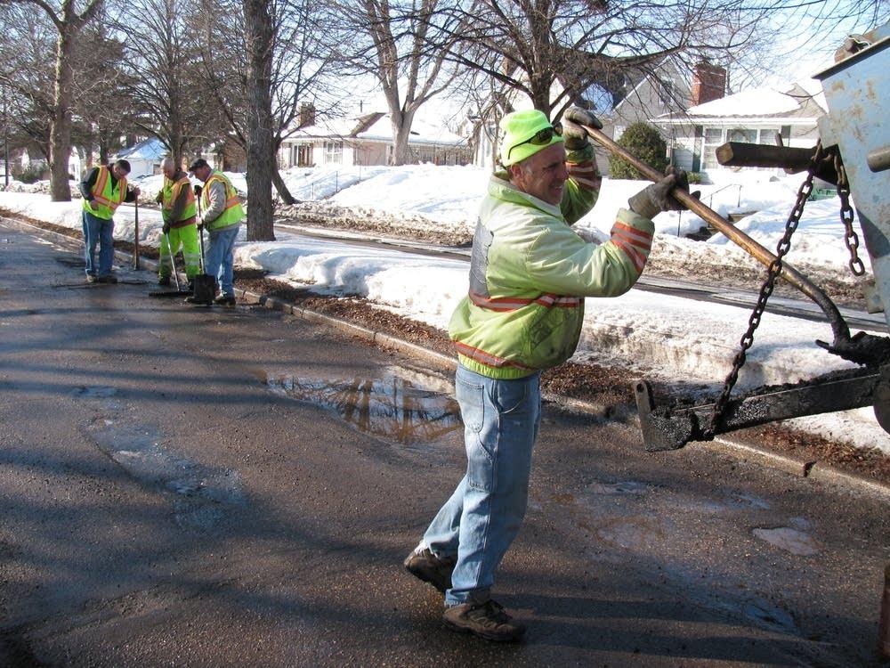 Steve Darwitz shoveling asphalt