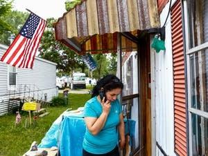 Antonia Alvarez calls neighbor Bill McConnell.