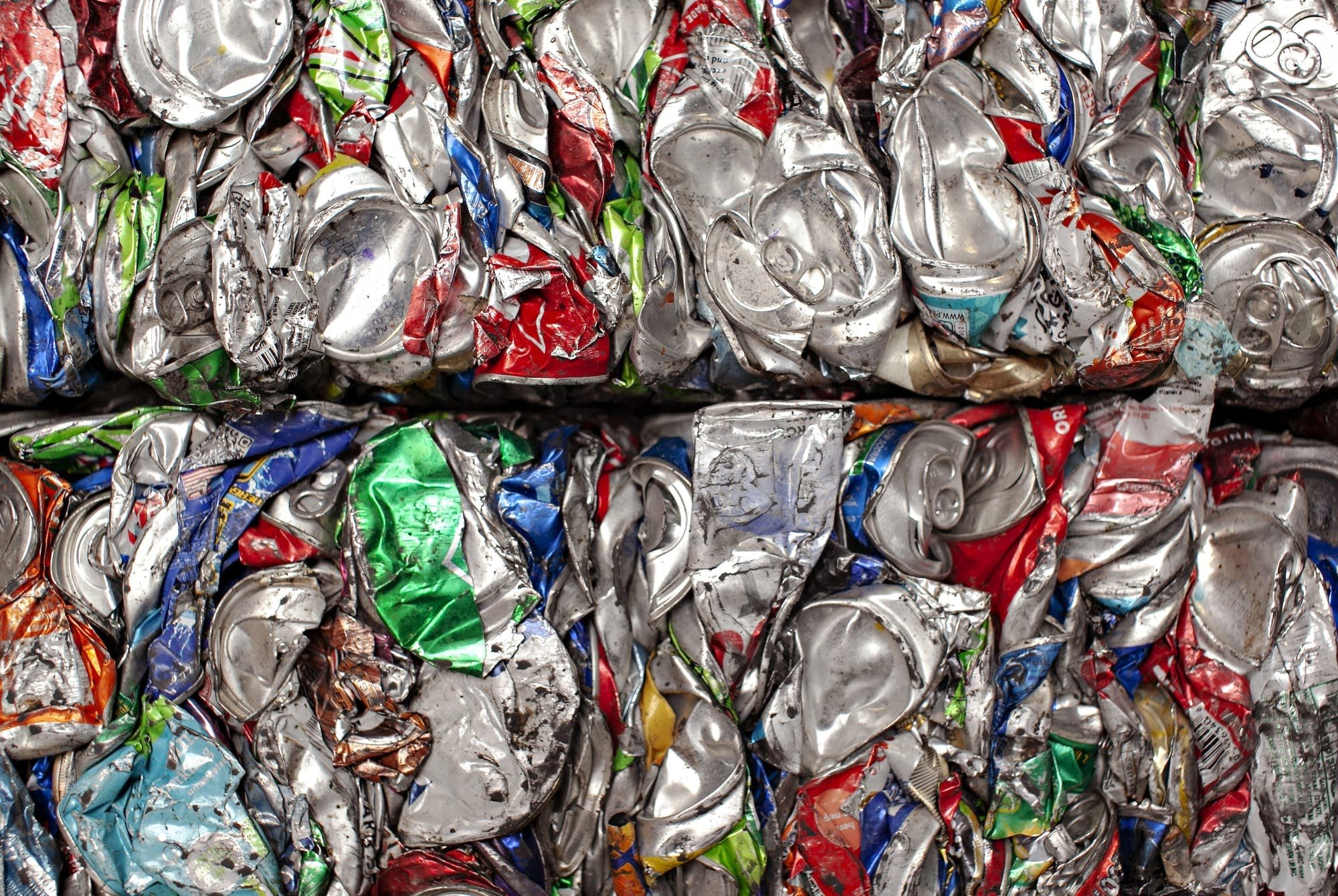 Compacted and baled aluminum cans await transport.