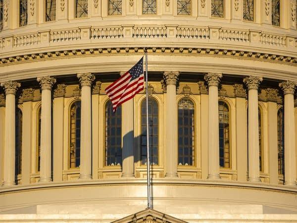 The rising sun illuminates the U.S. Capitol