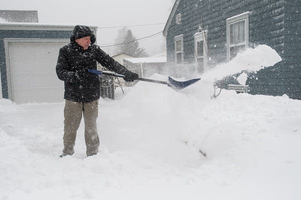 Tony Francour shovels snow off of his driveway in North Mankato.