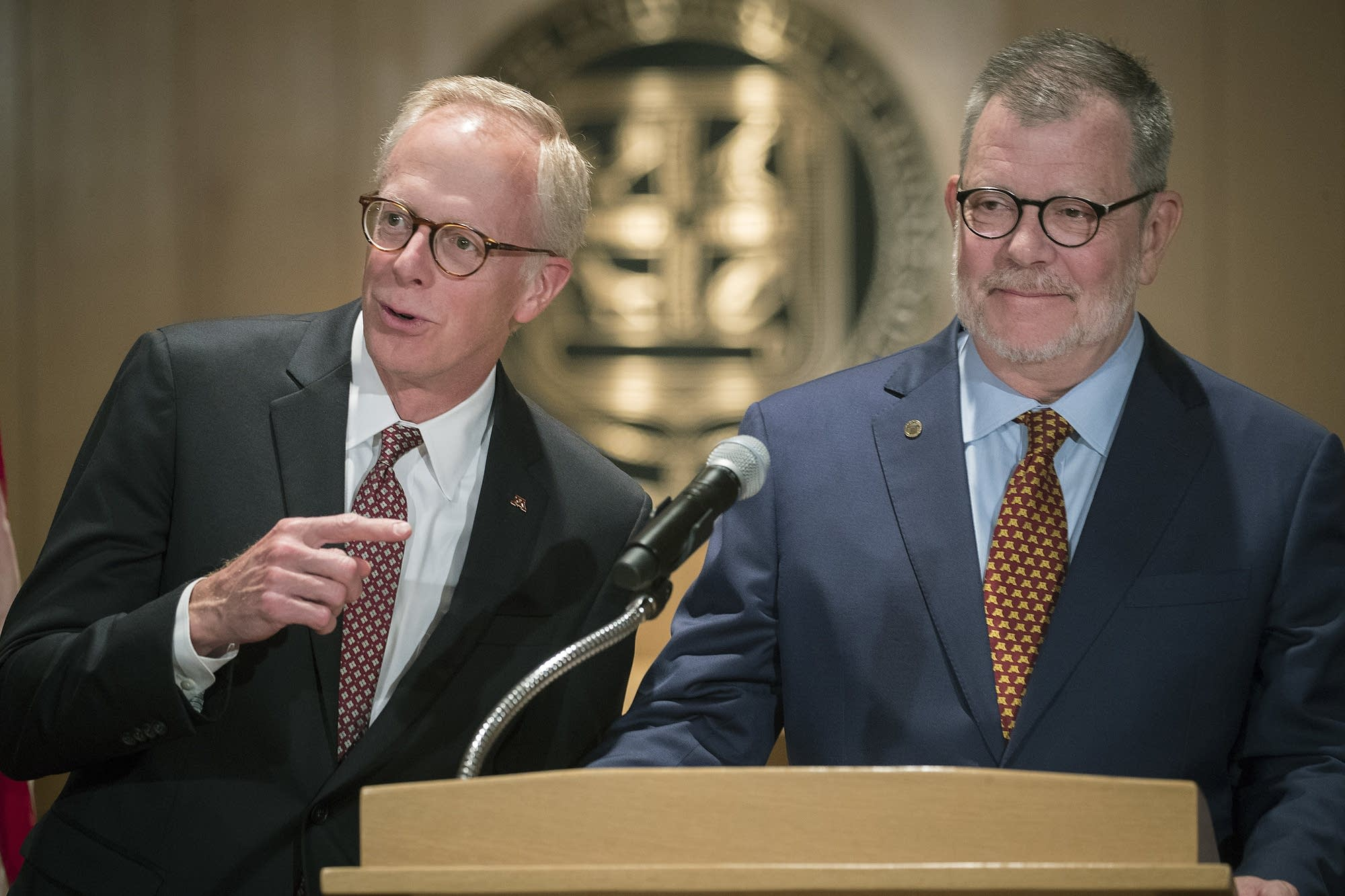 David McMillan, chair of the Board of Regents, left, and U pres. Eric Kaler