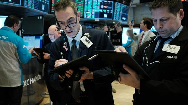 Traders work on the floor of the New York Stock Exchange on March 2.