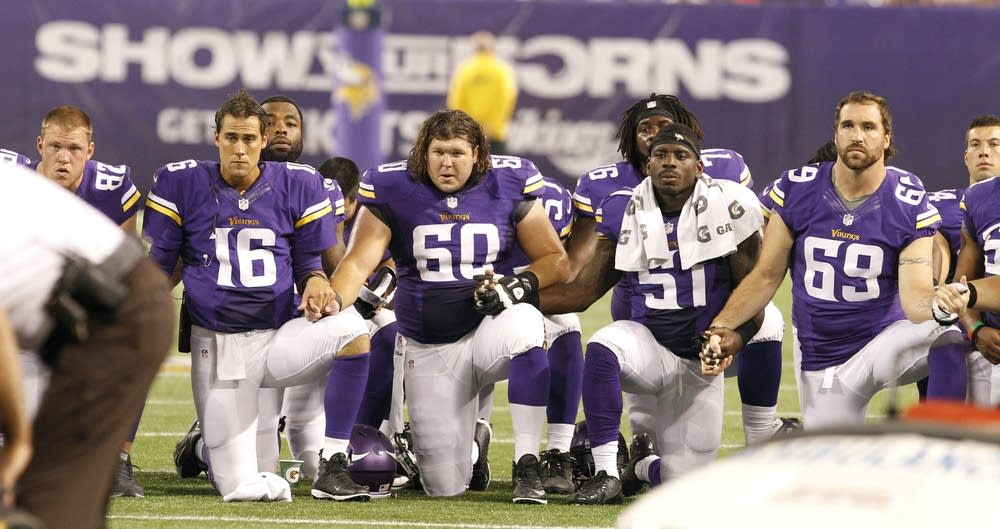 Minnesota Vikings players look on