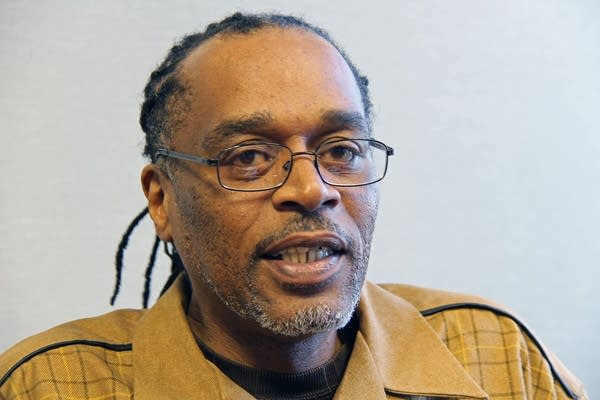 Frank Baker, 53, has reached a tentative settlement with St. Paul.