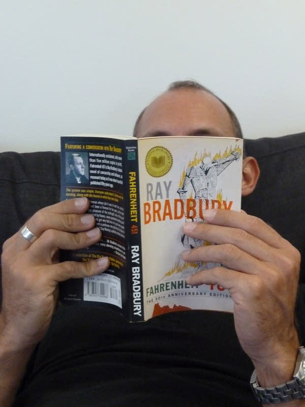 Man reading Bradbury novel