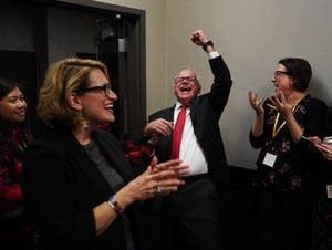 Walz and Flanagan celebrate.