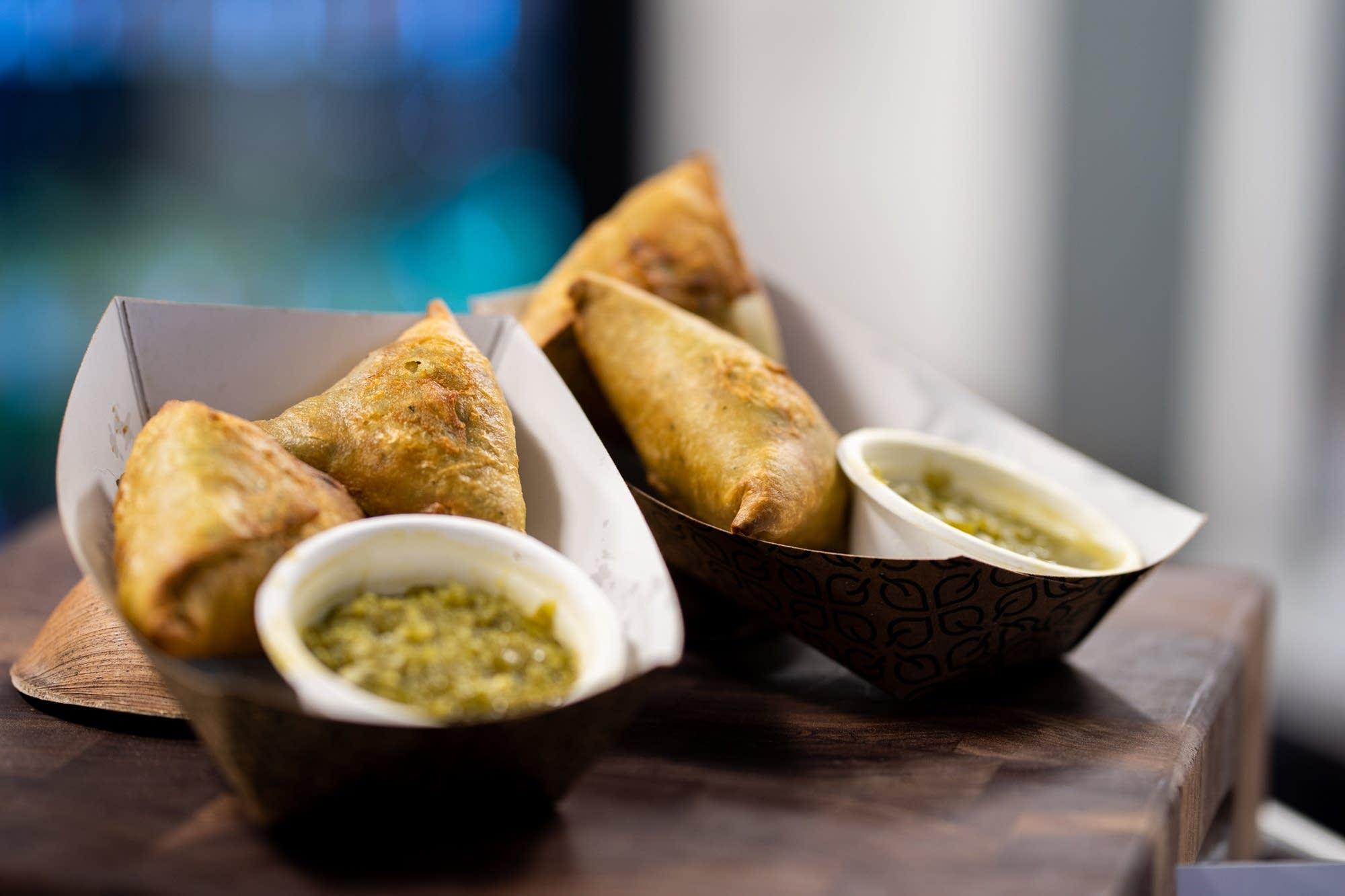 Afro Deli's veggie sambusas with green sauce.