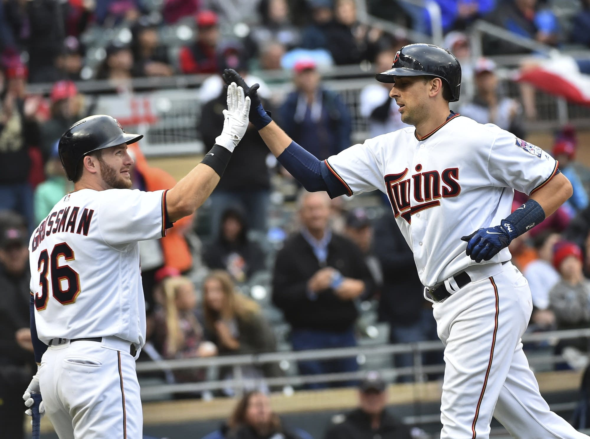 Twins hitter Jason Castro is welcomed at home by DH Robbie Grossman.