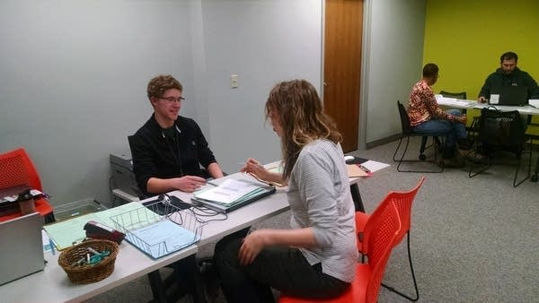 Staff members hold a discussion at Prepare and Prosper in St. Paul