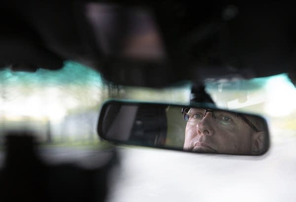 Police Chief Lee Sjolander drives through Kenyon, Minn.