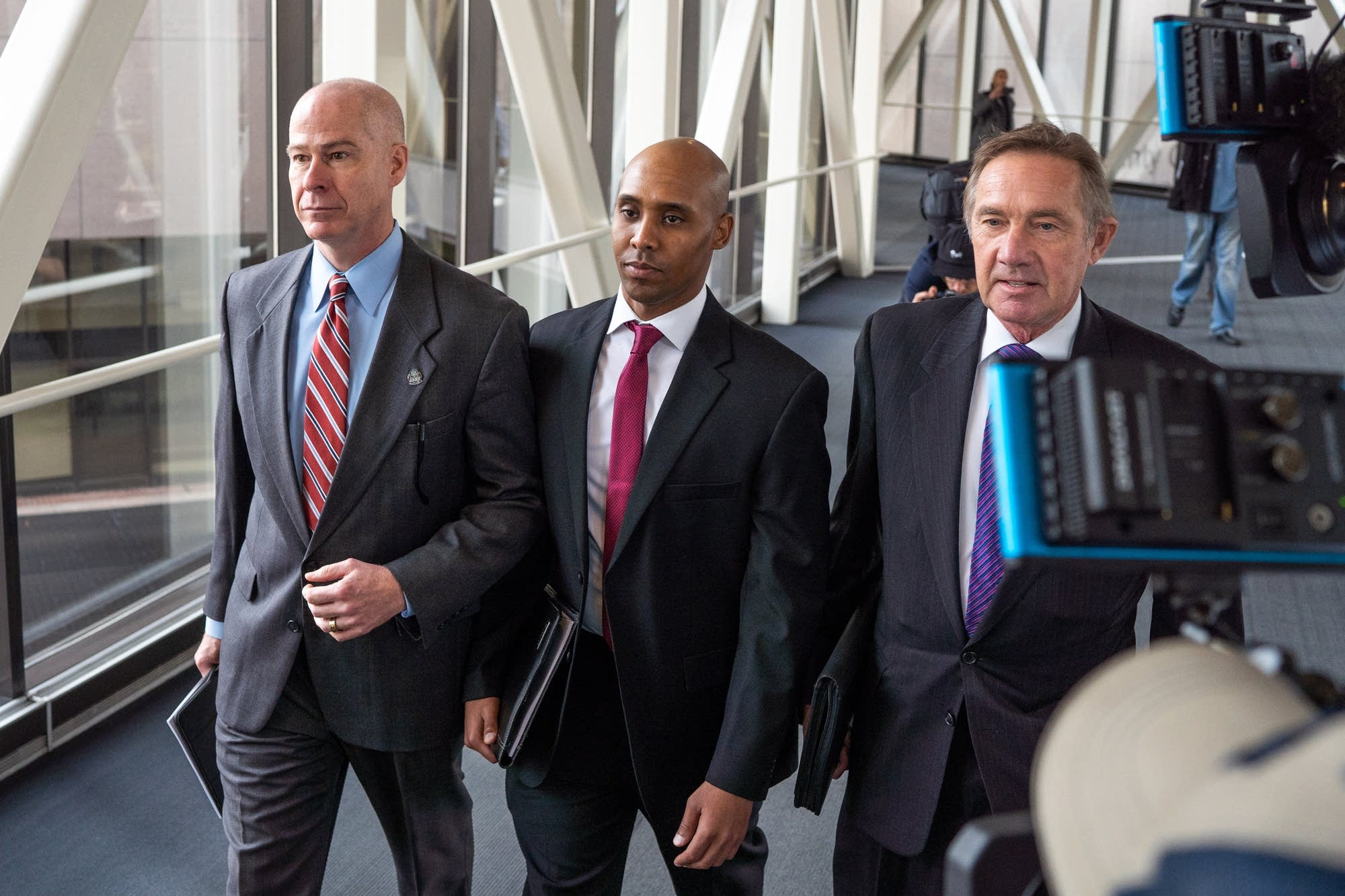 Mohamed Noor and his attorneys Thomas Plunkett and Peter Wold.