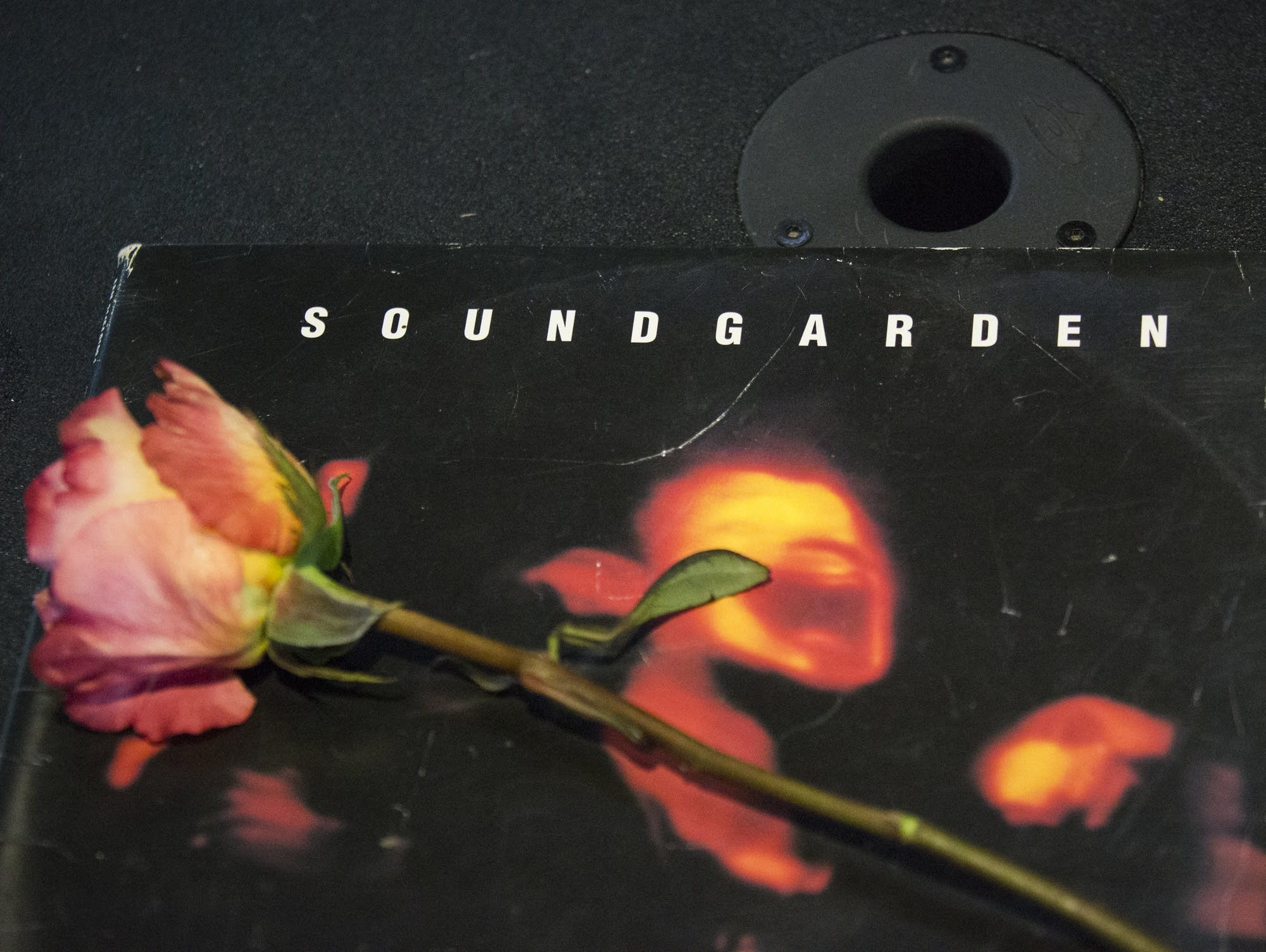 A rose sits atop a Soundgarden album during a Chris Cornell memorial