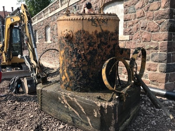 A diving bell was lifted from water and debris inside the boathouse