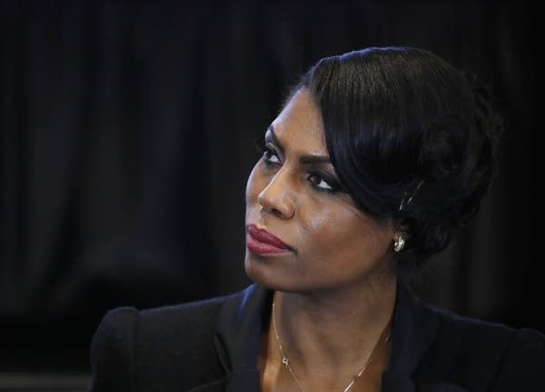Omarosa Manigault Newman listens to Vice President Pence.