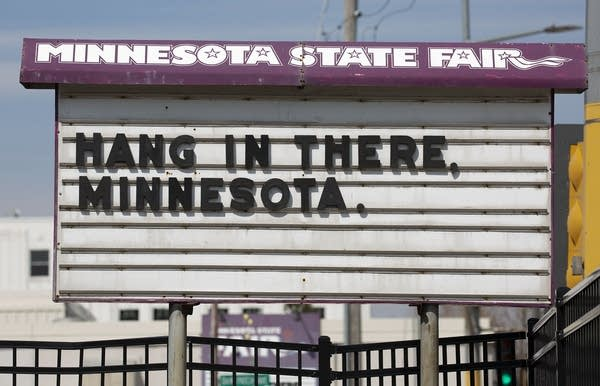 "A sign reads ""Hang in there, Minnesota."""