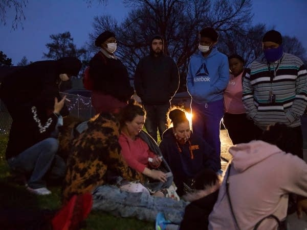 Family and friends gather near shooting scene
