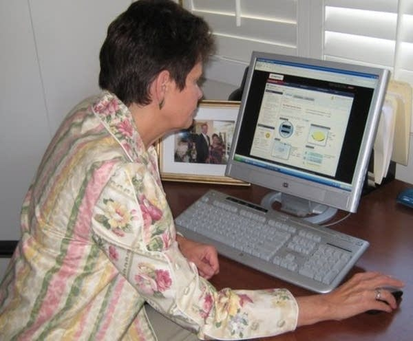Val Peterson at her computer.