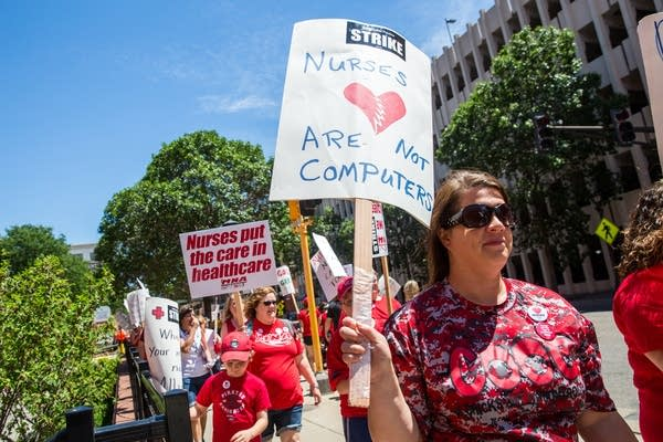 Nurses strike outside of United Hospital.