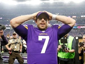 Case Keenum celebrates after defeating the New Orleans Saints.
