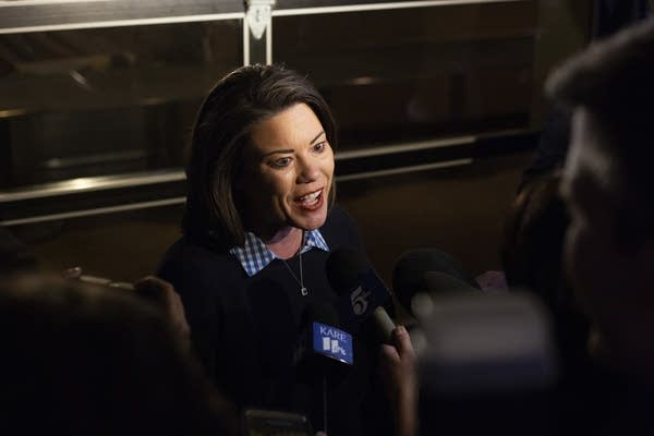 Angie Craig speaks to the news media as she enters her election party.
