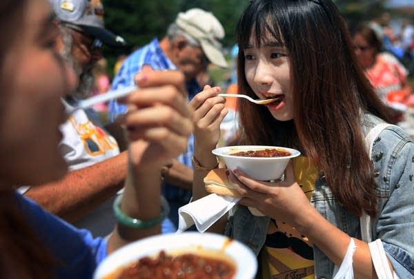 Gongmin Sheng tries the beans.