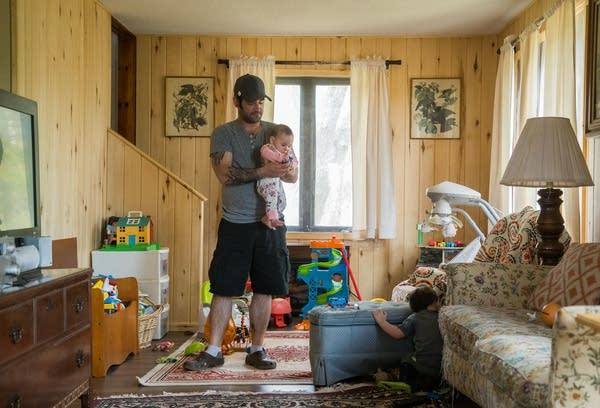 Jason Routley holds his seven-month-old daughter Eliza