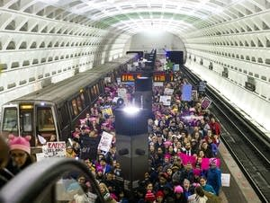 Washington, DC: Protesters arrive at the Capital South Metro station.
