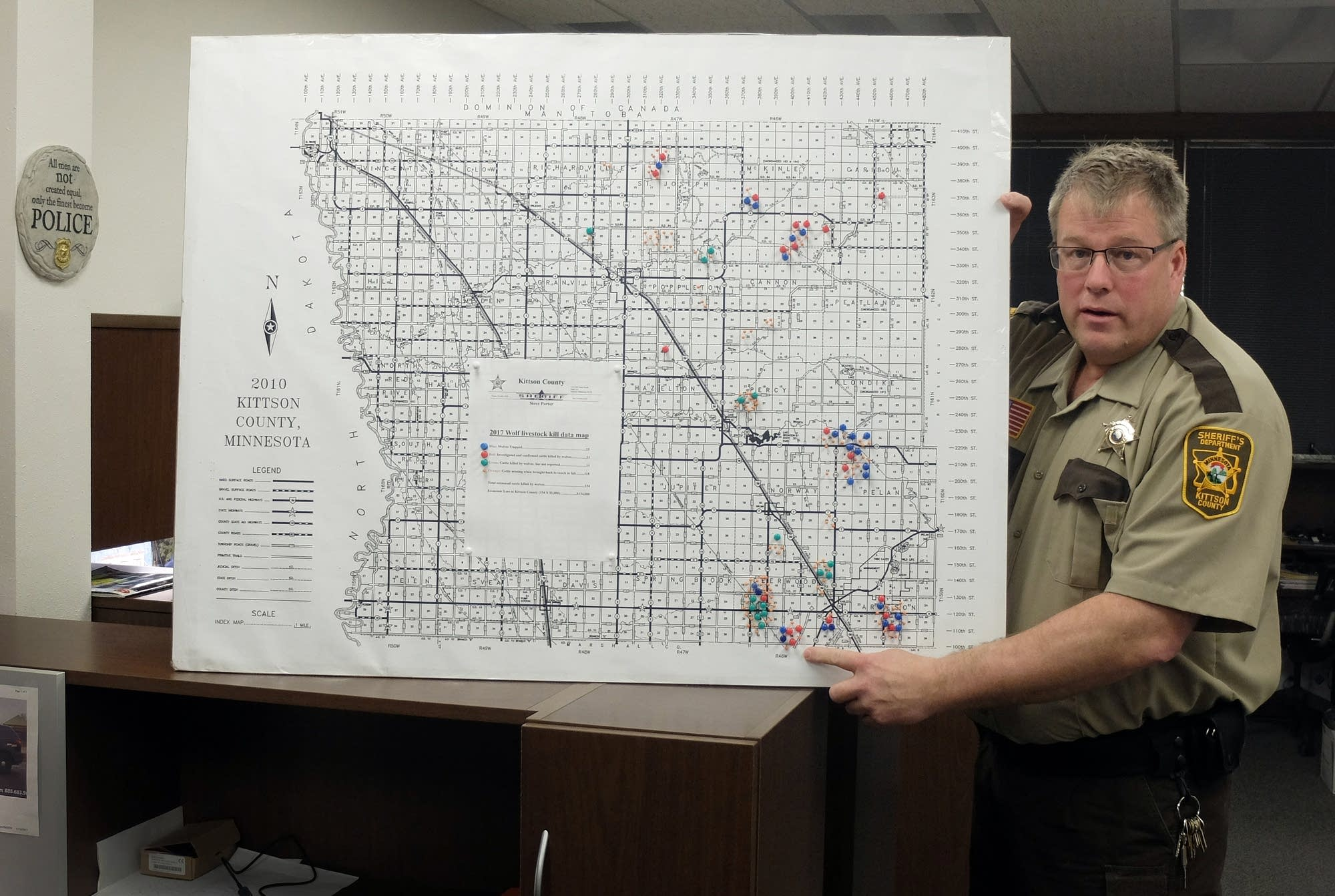 Sheriff Porter explains a map created to note cattle killed by wolves.