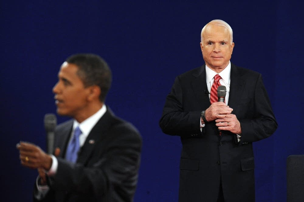 Sen. John McCain listens to Barack Obama answer