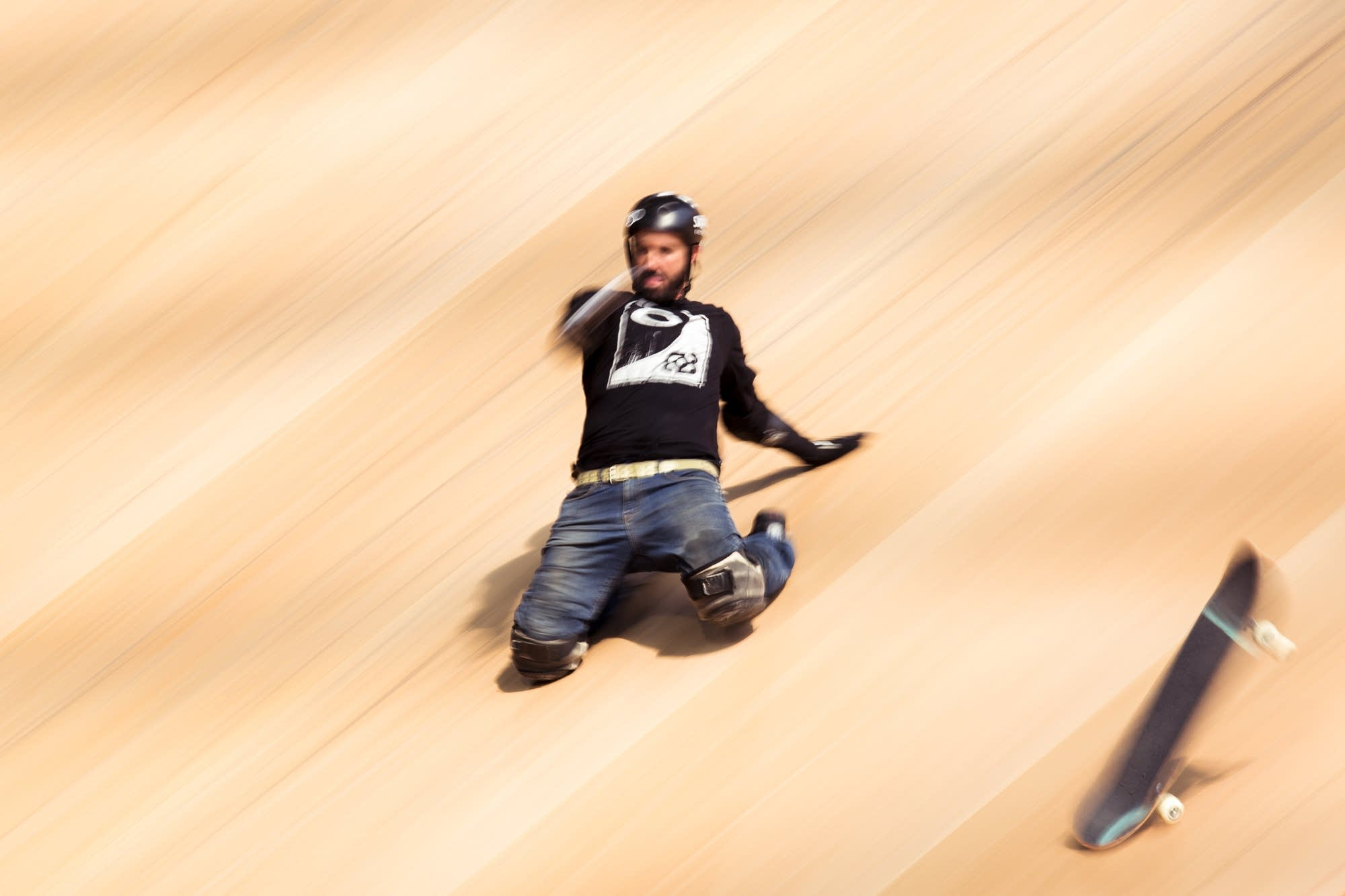 X Games legend Bob Burnquist slides down the Mega Ramp on his knees.