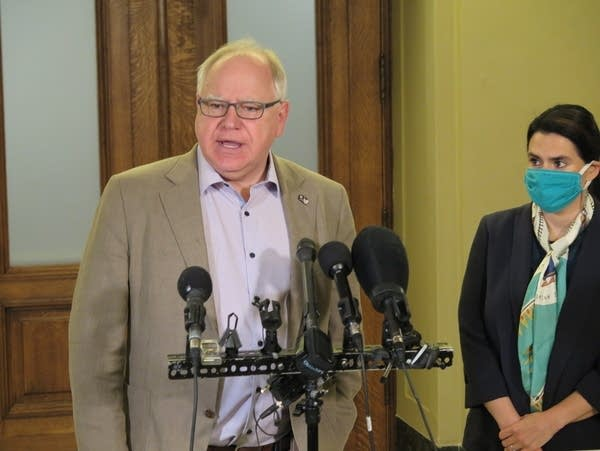 Minnesota Gov. Tim Walz speaks with reporters