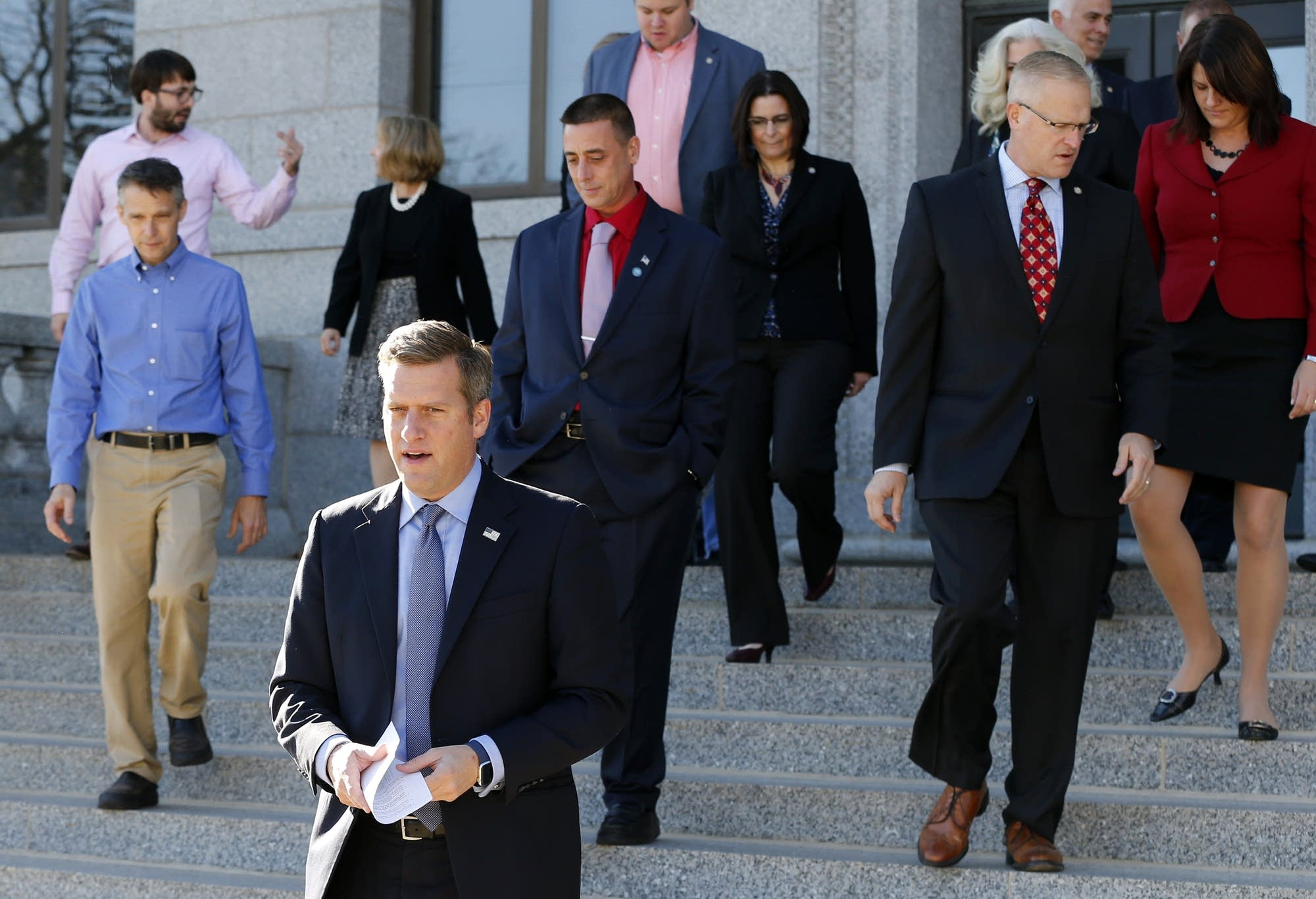 Kurt Daudt leads House member to press conference.