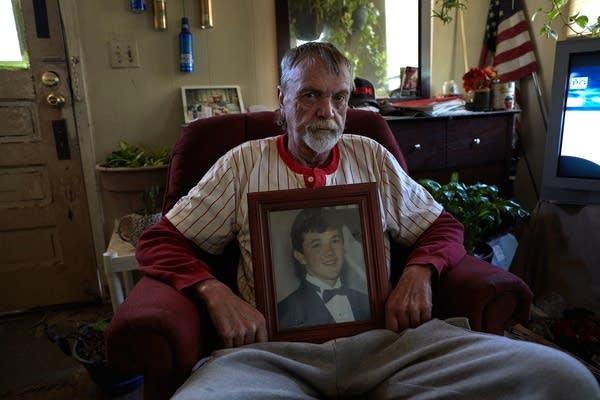Randy Stewart wears his late son Bobo's baseball jersey.