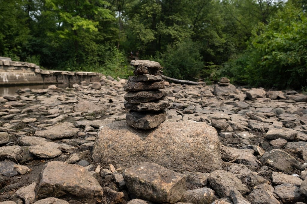 Rocks stacked in a dry creek.